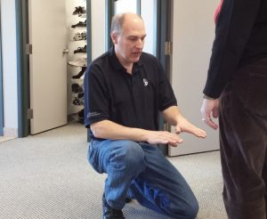 Fred Rayner measuring for orthotics at Applied Biomechanics